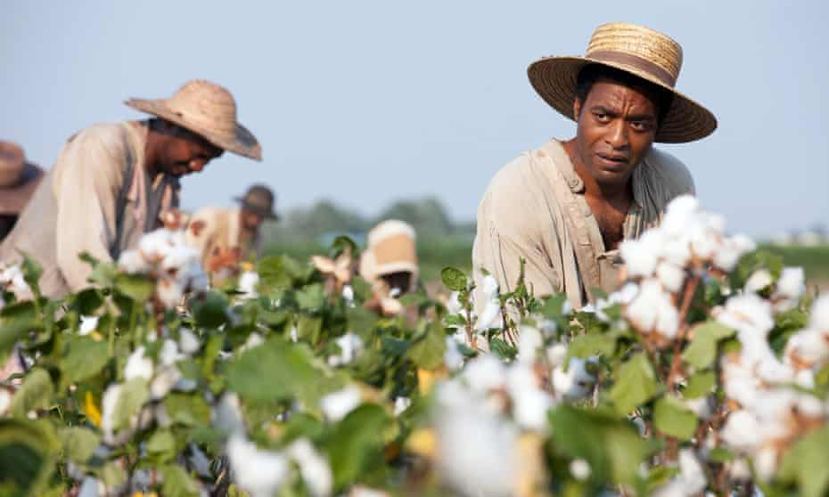 Chiwetel Ejiofor picks cotton in the 2013 film 12 Years a Slave.
