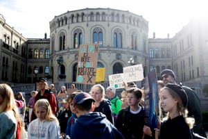 Students protest outside the Norwegian parliament in Oslo