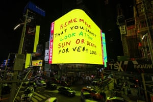 A billboard featuring animated artwork by British artist David Hockney in Times Square
