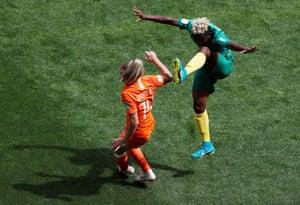 Cameroon's Genevieve Ngo Mbeleck goes high on Netherlands' Jackie Groenen.