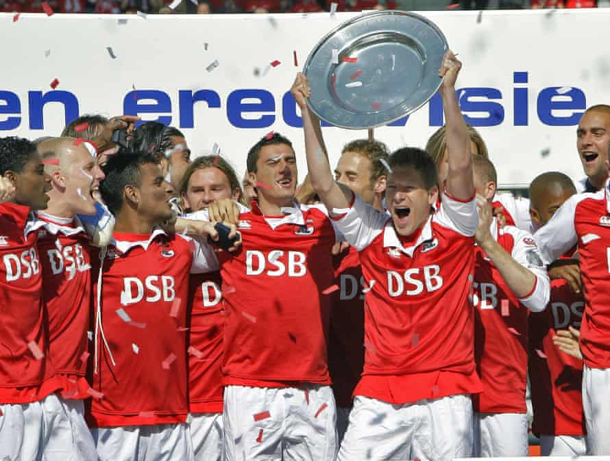 AZ Alkmaar's Stijn Schaars holds the champion plate as they are Champions of the Netherlands on May 10, 2009.