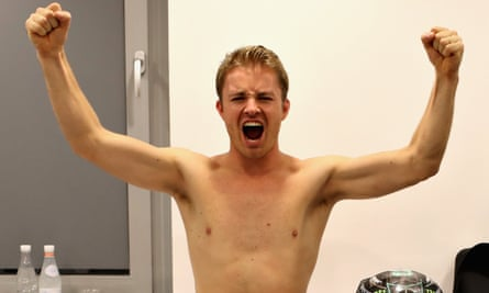Nico Rosberg raises his arms after retiring.