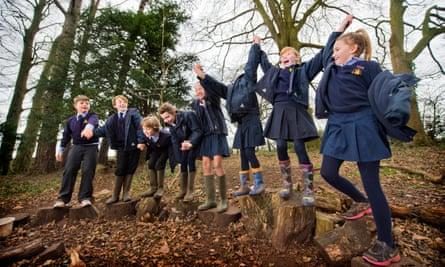 Year 6 pupils enjoying forest school.