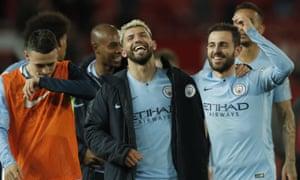 Manchester City's Sergio Aguero, center, and Manchester City's Bernardo Silva, right, celebrate at the end of the match.