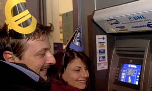 A couple withdraw their first euro banknotes from an ATM in Rome in the early hours of 1 January 2002.