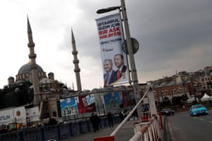 An election banner with the pictures of Turkish President Erdogan and AK Party mayoral candidate Yildirim is seen over the Galata bridge in Istanbul.
