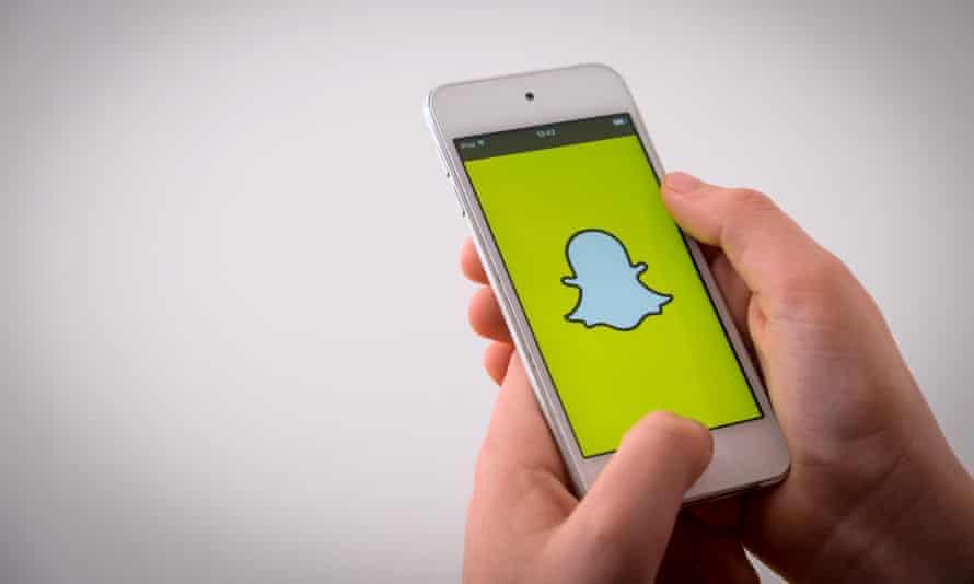 A boy using Snapchat