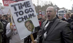 Demonstrators hold placards during a protest outside Downing Street yesterday.
