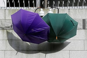 Umbrellas block security cameras outside the police HQ in Hong Kong