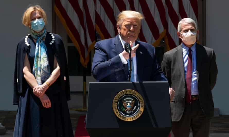 Drs Deborah Birx and Anthony Fauci wear face masks as they listen to Donald Trump speak in the Rose Garden of the White House on 15 May.
