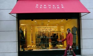 A pedestrian passes Barneys New York, on Madison Avenue