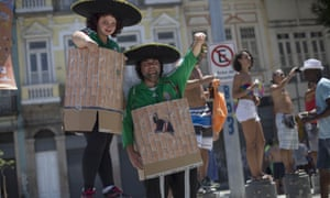 Costumes mocking Donald Trump's proposed Mexican border wall at a pre-carnival parade in Rio