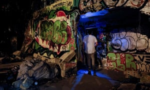 A man enters an illegal party located in an abandoned warehouse in Gennevilliers, north of Paris, on 1 August 2020.