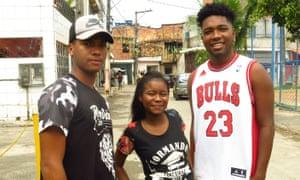 Everton de Freitas, 18, Laisa Conceição, 17, and Eliseu Assunção, 18, in Salvador's Pau da Lima favela.