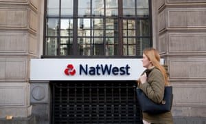 City workers walk past Natwest Bank