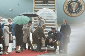 President Ford slips as he exits Air Force One, 1975.