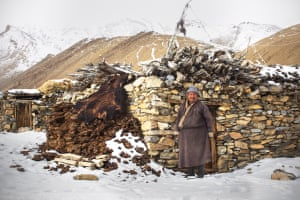 A herder stands proudly in front of his winter house in Dat. The yak skin will be dried out and the hair used to make a tent to live in during spring/summer in the Zara Valley.