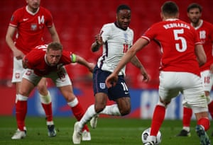 Raheem Sterling of England runs with the ball