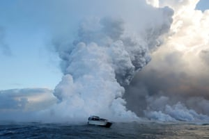 HawaiiA tourist boat gets close to a lava flow spilling into the Pacific Ocean during eruptions of the Kilauea volcano.