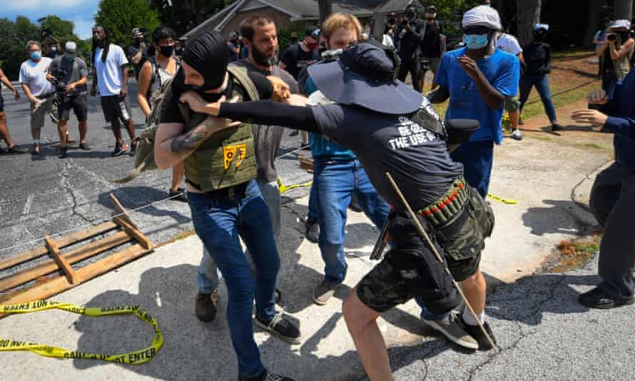 Rightwing demonstrators and counter-protesters fight during a rally in Stone Mountain, Georgia, on 15 August.