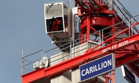 A worker operates a Carillion crane