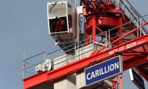 A worker operates a crane on Carillion's Midland Metropolitan hospital site in Smethwick