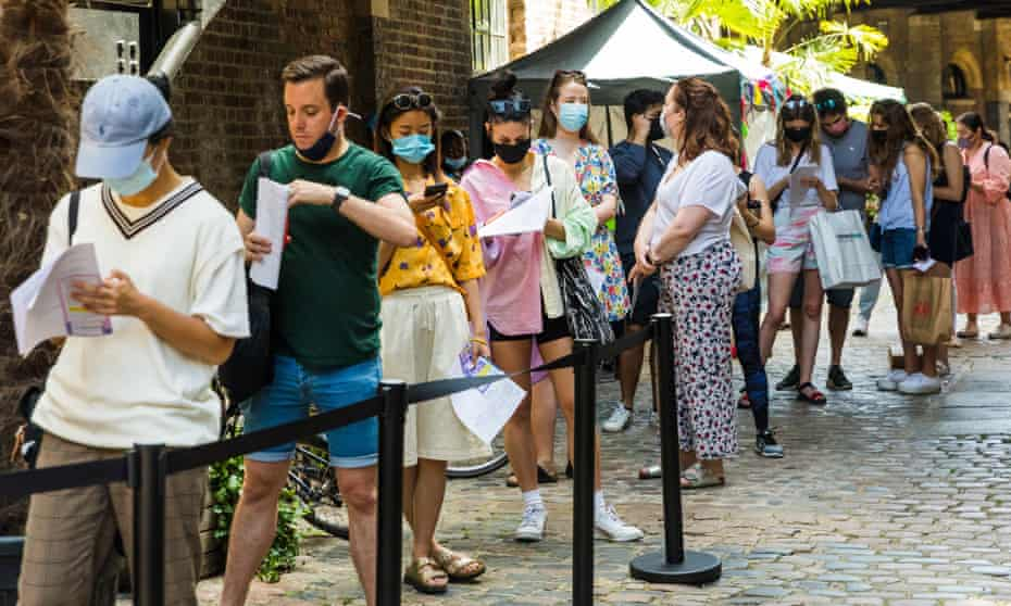 People queue at a pop-up Covid vaccination centre in Camden