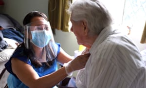 A care worker visiting a client in their home.