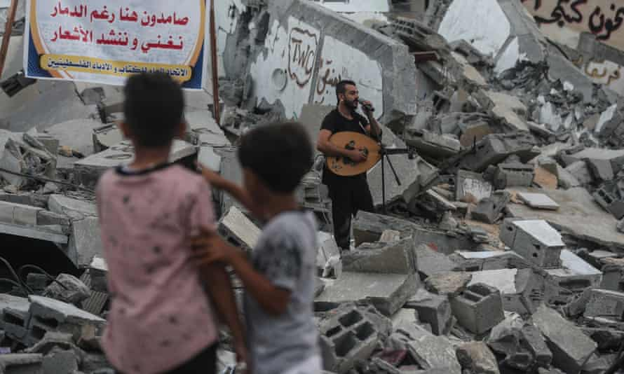 The Egyptian band Devavin perform on 15 August in the ruins of the Said al-Mishal Cultural Centre in Gaza, which was destroyed by Israeli airstrikes six days earlier
