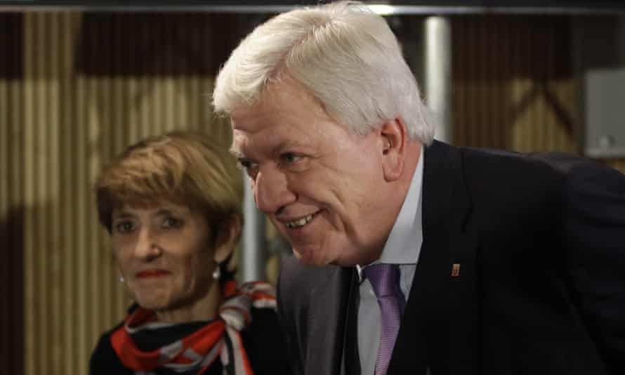 Hesse's state premier, Volker Bouffier, arrives with his wife Ursula for an election party