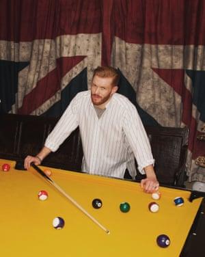 A model wearing a Stella McCartney shirt while playing pool