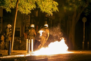"A petrol bomb explodes next to riot police during minor clashes in central Athens, Greece early July 6, 2015. Greeks voted overwhelmingly ""No"" on Sunday in a historic bailout referendum, partial results showed, defying warnings from across Europe that rejecting new austerity terms for fresh financial aid would set their country on a path out of the euro. REUTERS/Marko Djurica"