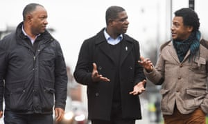 Gilbert Morgan (centre) talks to men about cancer screening in Manchester.