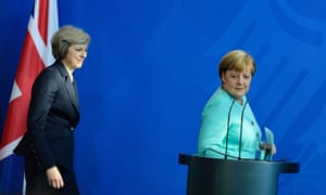 Angela Merkel (right) and Theresa May preparing to address a press conference in Berlin in July 2016
