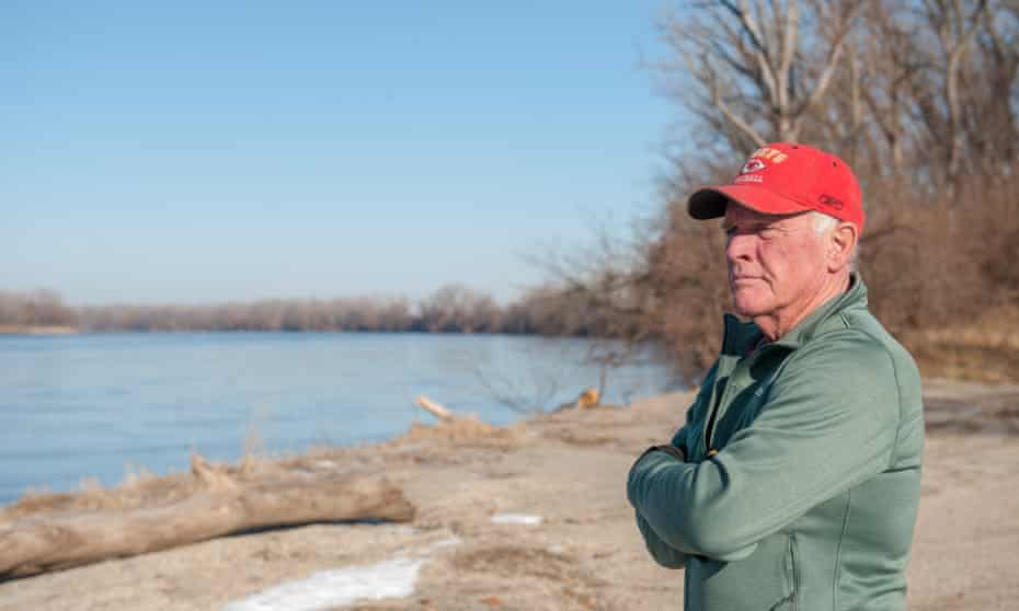 Richard Oswald looks out at the Missouri River from a lookout point. The river runs two miles west of his farmland.