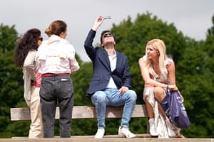 Members of the public watch the partial solar eclipse from Primrose Hill in central London