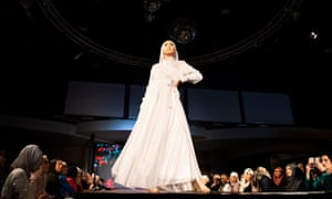 A model in a silver-white ensemble on the catwalk at Mod Runway.