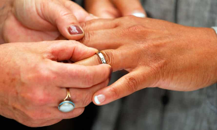A female couple exchange rings during their civil partnership ceremony