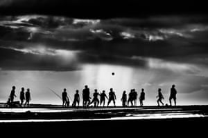 Pekutatan beach, Bali. About an hour before sunset kids would gather to play football – and stay until dark. I photographed them over several days, hoping to get a nice sunset silhouette.