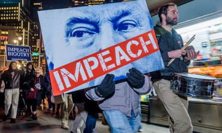 A protest calling for the impeachment of Trump in New York City on 30 November 2017.