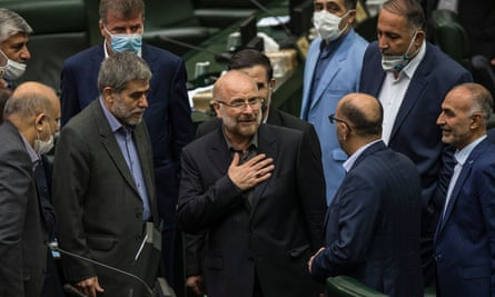 The recently elected Iranian parliament speaker Mohammad Baqer Qalibaf (centre) has said negotiation with the US is 'harmful and forbidden'