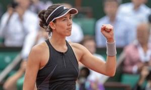 Garbiñe Muguruza celebrates her 6-2, 6-1 victory over Maria Sharapova.