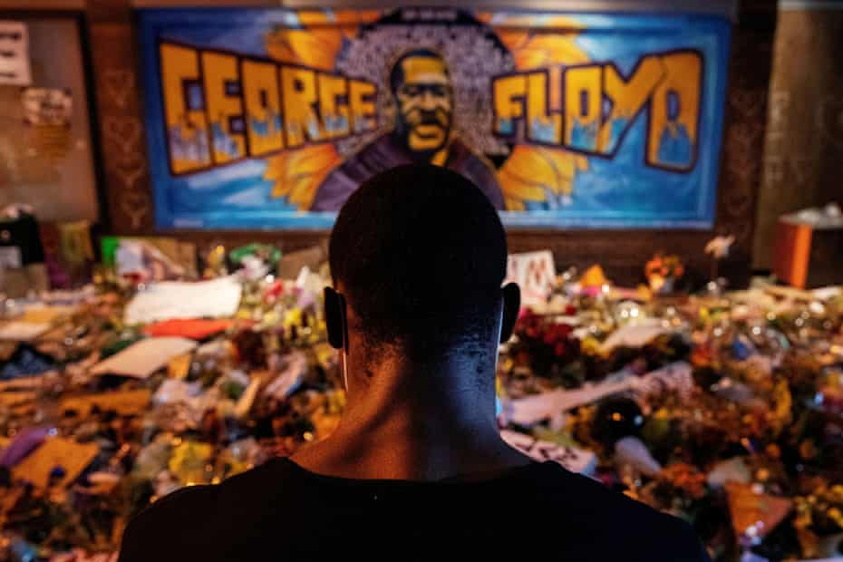 A man recites spoken word poetry at a memorial honoring George Floyd, at the spot where he was taken into custody, in Minneapolis.