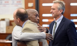 Dewayne Johnson (centre) was awarded £226m in damages from Monsanto.