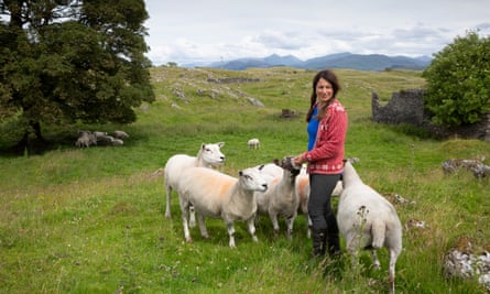 Tamsin Calidas with a few sheep around her on a remote Scottish island