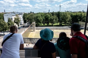 Visitors look down on a surviving section of wall from an observation platform