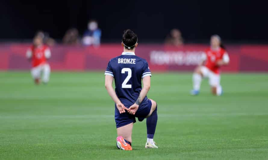 Lucy Bronze takes the knee at the start of Team GB's opening football match against Chile at the Tokyo Olympics.