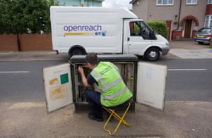 An engineer for BT Openreach works on a network cabinet in Enfield, UK.