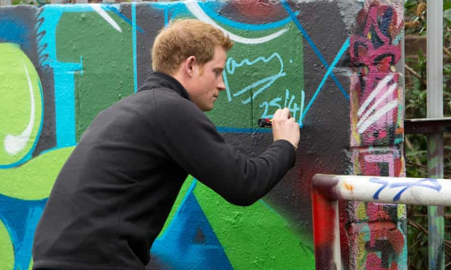 Prince Harry adds his tag to a wall at a Nottingham youth club in 2013.