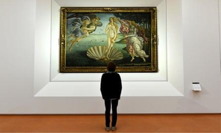 A man looks at Botticelli's The Birth of Venus